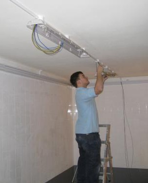 Installation of lighting in commercial kitchen.jpg