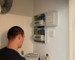 Our Cardiff electrician testing a fuse box for a landlords rented accommodation